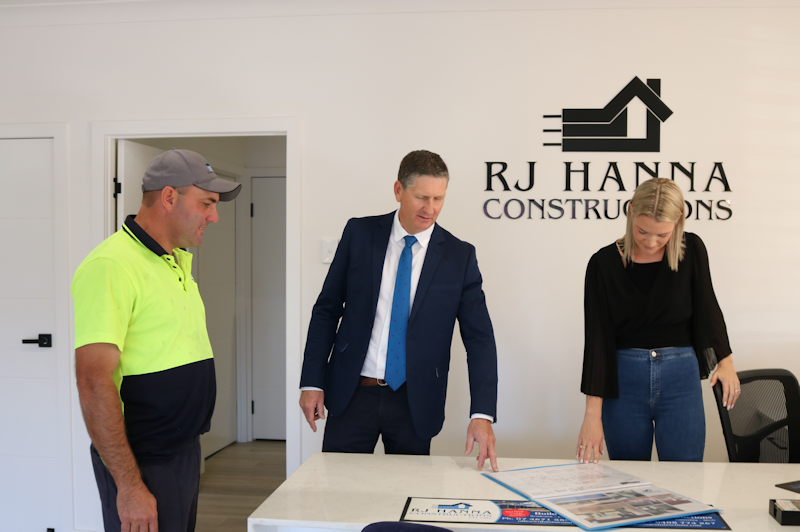 robbie hanna, The Honourable Councillor Lawrence Springborg AM, and Lisa Hanna perusing plans at RJ Hanna Constructions