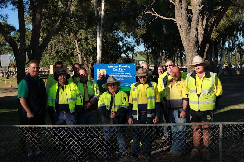 grc staff in front of the sign at the carpark named after george fleming at the goondiwindi cemetery